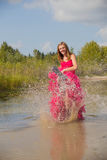 Girl prom dress splashing water Royalty Free Stock Images