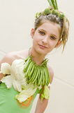 Girl promoting healthy food Royalty Free Stock Image