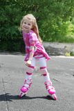 Girl in protection rollerskating Stock Photos