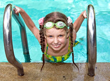 Girl in protective goggles leaves pool. Stock Image