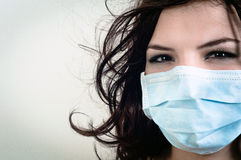 A girl in a protective mask Royalty Free Stock Photos