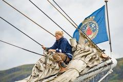 Girl on prow of Tall Ship Christian Radich. Stock Photos