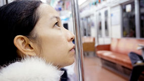 Girl in public transportation train Royalty Free Stock Image