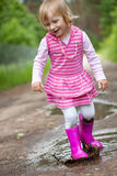 Girl in a puddle Stock Photos