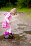 Girl in a puddle Royalty Free Stock Photography