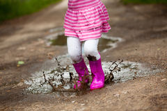 Girl in a puddle Royalty Free Stock Image