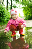 Girl in puddle Stock Image