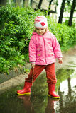 Girl in puddle Stock Photo