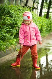 Girl in the puddle Stock Image