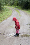 Girl in puddle royalty free stock photo