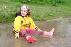 Girl in the puddle Royalty Free Stock Images