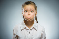 The girl puffed out her cheeks Stock Photo