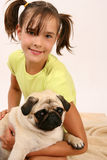 Girl with pug. Beautiful girl with her sweet pug Royalty Free Stock Photography