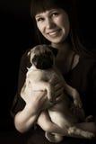 Girl and pug Stock Photos