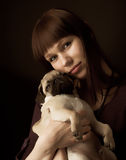 Girl and pug Royalty Free Stock Image
