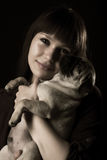 Girl and pug Royalty Free Stock Photos
