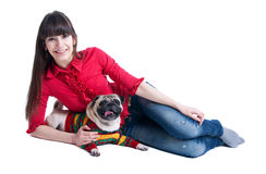 Girl and pug dog Stock Photography