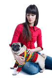 Girl with a pug dog Stock Photos
