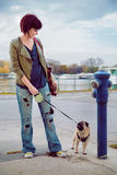 Girl and pug looking at each other Royalty Free Stock Photo