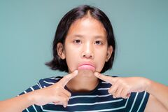 Free Girl Pull The Mouth As Sulky Face Stock Image - 187756411