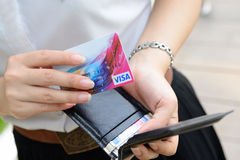 Girl Pull visa card from wallet. Gird Pull visa card from wallet Royalty Free Stock Images