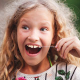 Girl pulled himself teeth Royalty Free Stock Images