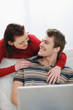 Girl pulling attention of boyfriend from laptop Royalty Free Stock Photos