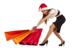 Girl pulling christmas shopping bags Royalty Free Stock Photos