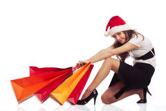 Girl pulling christmas shopping bags Stock Images
