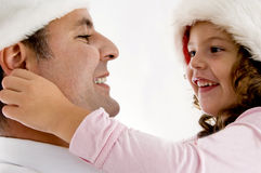 Girl pulling father's ears Royalty Free Stock Photography