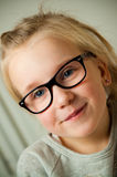 Girl pulling a funny face. Cute young girl in glasses pulling a funny face Royalty Free Stock Photography