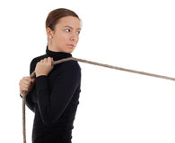 Girl pulling grey rope Stock Photography
