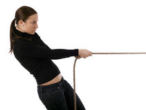 Girl pulling grey rope, tug-of-war Stock Photos