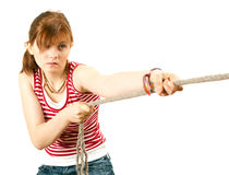 Girl pulling grey rope, tug-of-war Royalty Free Stock Photography
