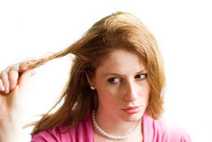 Girl pulling her hair. Redhead young beautiful girl pulling her hair Royalty Free Stock Images
