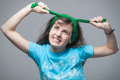Girl pulling her hair Royalty Free Stock Photo