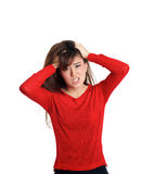 Girl pulling her hair making a disbelieved gesture Stock Photo