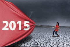 Girl pulling number 2015. Asian girl pulling a big number of 2015 under stormy sky vector illustration