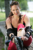 Girl pulling on rollerblades stock photos