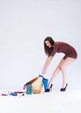 Girl pulls bag Stock Images