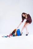 Girl pulls bag Stock Photography