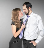 Girl pulls the guy for a tie Stock Photo