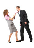 Girl pulls a man in a tie Stock Photography