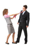 Girl pulls a man in a tie Stock Images