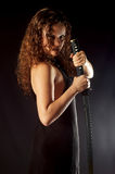 Girl pulls out sword Royalty Free Stock Photography