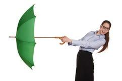 Girl pulls to itself open umbrella Royalty Free Stock Image