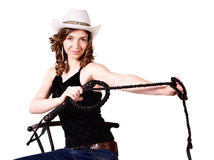 Girl pulls a whip. Girl in a cowboy hat pulls a whip royalty free stock image