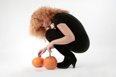 Girl with pumkins Royalty Free Stock Photography