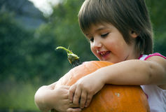 Girl and pumpkin Stock Photography