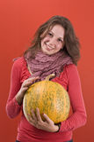 Girl and pumpkin Stock Image